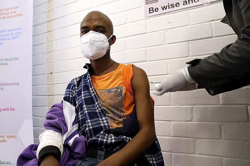 A man getting an injection during a clinical trial for a potential Covid-19 vaccine at the Baragwanath hospital in Soweto, South Africa, on June 24. The world faces problems of how to produce enough vaccines to meet global demand, and how to ensure i