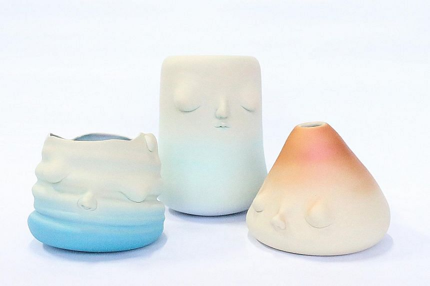 Ceramic artist Fyon Cheong (left) hopes to convey the gamut of emotions people are feeling during this pandemic with a trio of vases titled Put An End To (above).