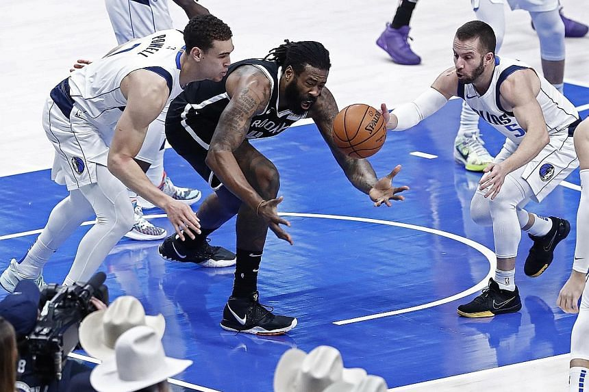 Brooklyn's DeAndre Jordan (in black, playing against Dallas in January) announced on Monday that he had contracted Covid-19. The centre will not feature when the NBA resumes on July 30. PHOTO: EPA-EFE