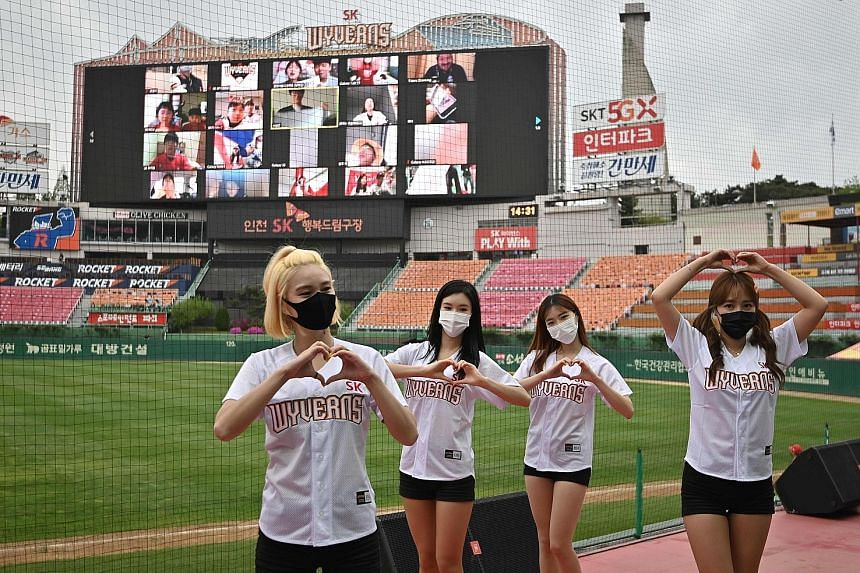 Cheerleaders at a game in Incheon on May 5, when South Korean baseball action resumed behind closed doors. Fans, who have been cheering from home over the past two months, are expected to return in limited numbers some time this month. PHOTO: AGENCE