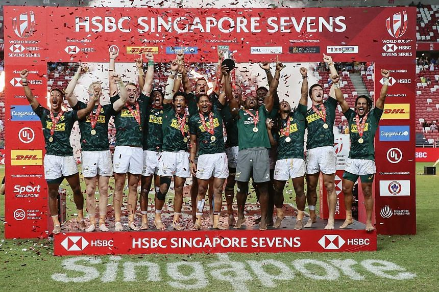 South Africa rugby sevens players celebrating after edging out Fiji 20-19 in last year's Singapore final at the National Stadium. They will not get to defend their title till next April. PHOTO: EPA-EFE