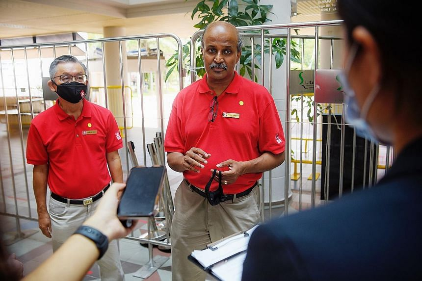 Singapore Democratic Party chairman Paul Tambyah, seen here with fellow party member Tan Jee Say, speaking to the press after nomination proceedings at Methodist Girls' School. Prof Tambyah will contest in Bukit Panjang SMC while party chief Chee Soo