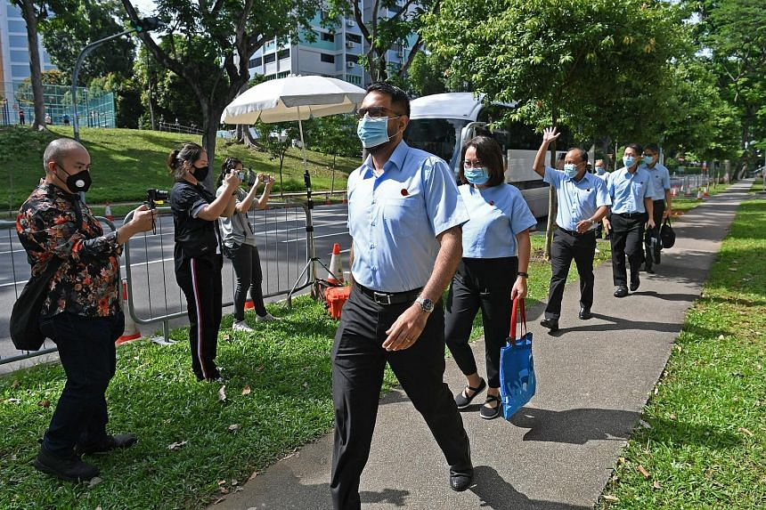 The Workers' Party's (from far left) Mr Pritam Singh, Ms Sylvia Lim, Mr Faisal Manap, Mr Gerald Giam and Mr Leon Perera - who are standing for election in Aljunied GRC - arriving at the Deyi Secondary School nomination centre yesterday. ST PHOTO: DES