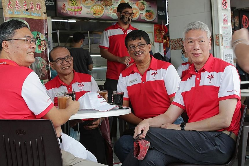 Mr Lee Hsien Yang (at right) with three members of the PSP's Tanjong Pagar GRC team - (from left) Mr Michael Chua, Mr Abas Kasmani and Mr Harish Pillay - at a coffee shop near the nomination centre for Tanjong Pagar GRC yesterday morning. ST PHOTO: G