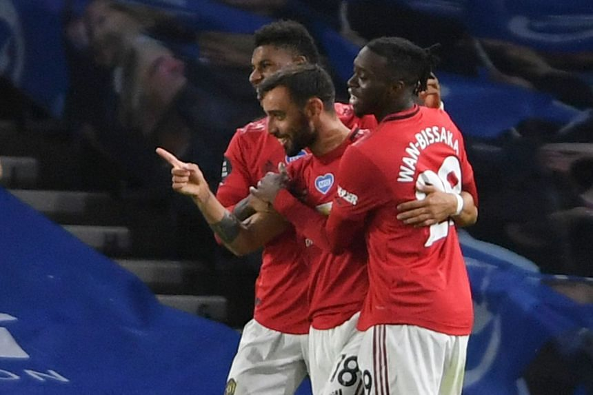 Fernandes (centre) celebrates scoring United's third goal.