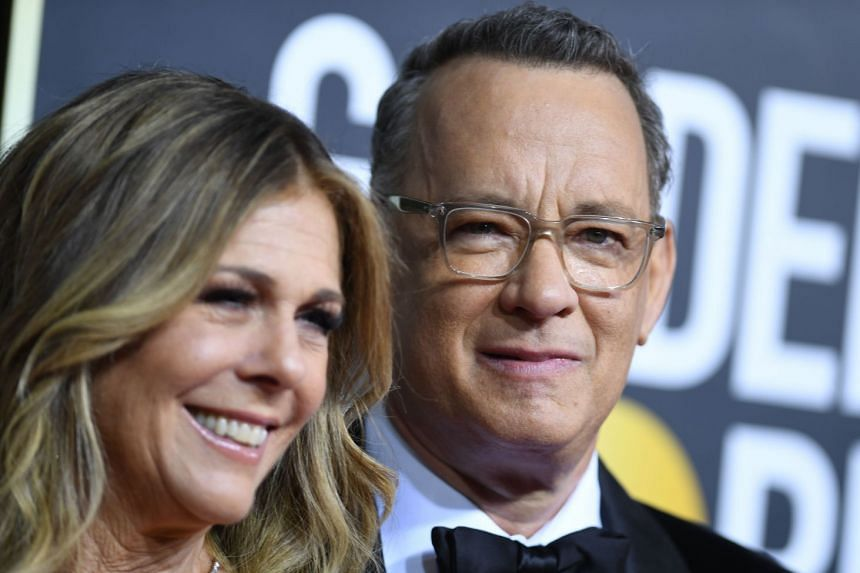 A January 2020 photo shows US actor Tom Hanks and wife Rita Wilson arriving for the 77th annual Golden Globe Awards.
