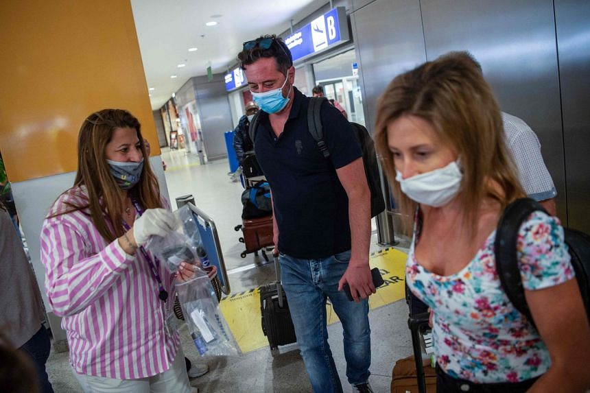 Passengers of a flight from Paris arrive at Eleftherios Venizelos International Airport in Athens on June 15, 2020.