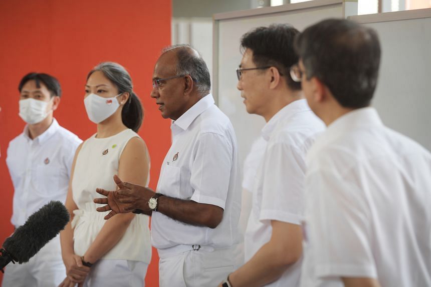 The PAP's candidates for Nee Soon GRC, (from left) Mr Louis Ng, Ms Carrie Tan, Mr K. Shanmugam, Mr Derrick Goh, and Associate Professor Muhammad Faisal Ibrahim, at the Chongfu School nomination centre on June 30, 2020.