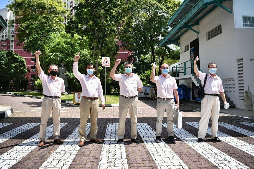 NSP Tampines GRC team members (from left) Mr Choong Hon Heng, Mr Mohd Ridzwan Mohammad, Mr Reno Fong Chin Leong, Mr Eugene Yeo, and Mr Vincent Ng Kian Guan.