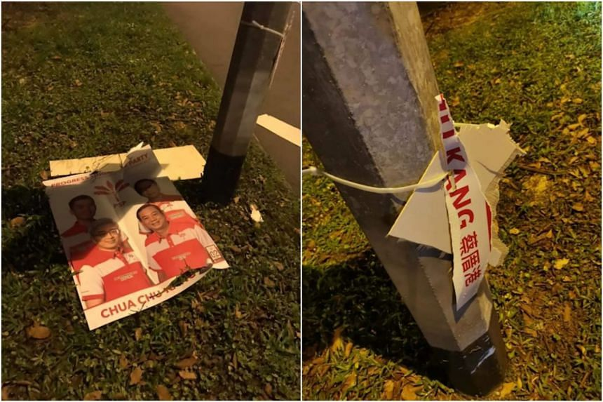 The Progress Singapore Party's posters were ripped from lamp posts and found on the road and grass patches.