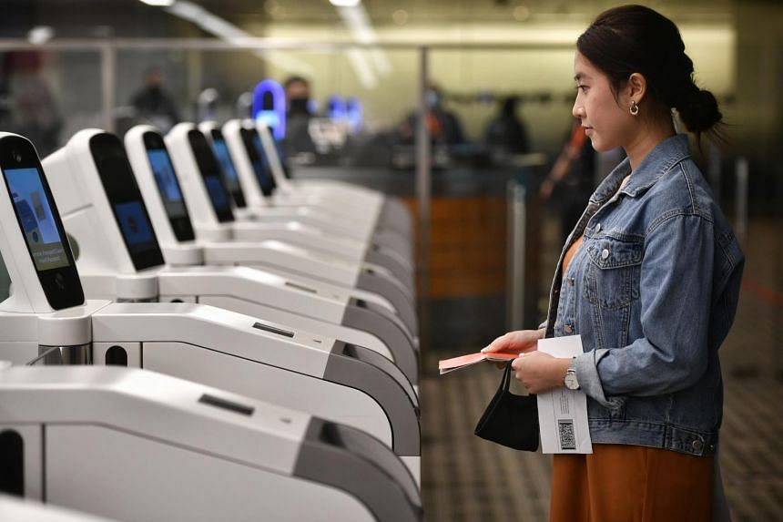 Passengers who have enrolled their iris and facial biometrics will be prompted to look into the cameras after scanning their passport, for identity verification.