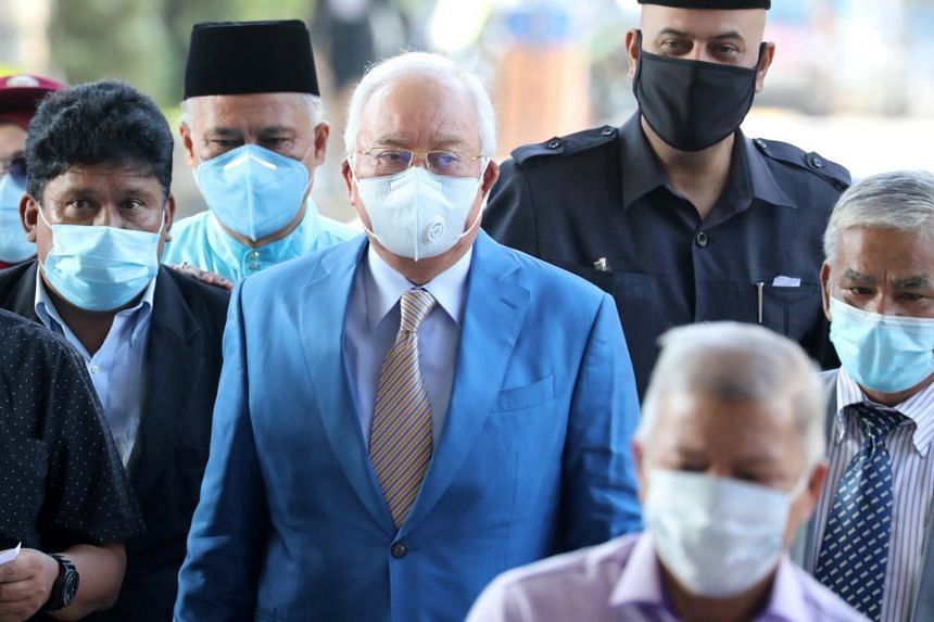 Former Malaysian prime minister Najib Razak and his supporters arriving at the Kuala Lumpur High Court on June 1, 2020.