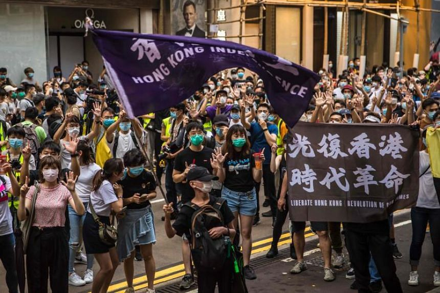 Protesters chant slogans during a rally against a new national security law in Hong Kong, on July 1, 2020.