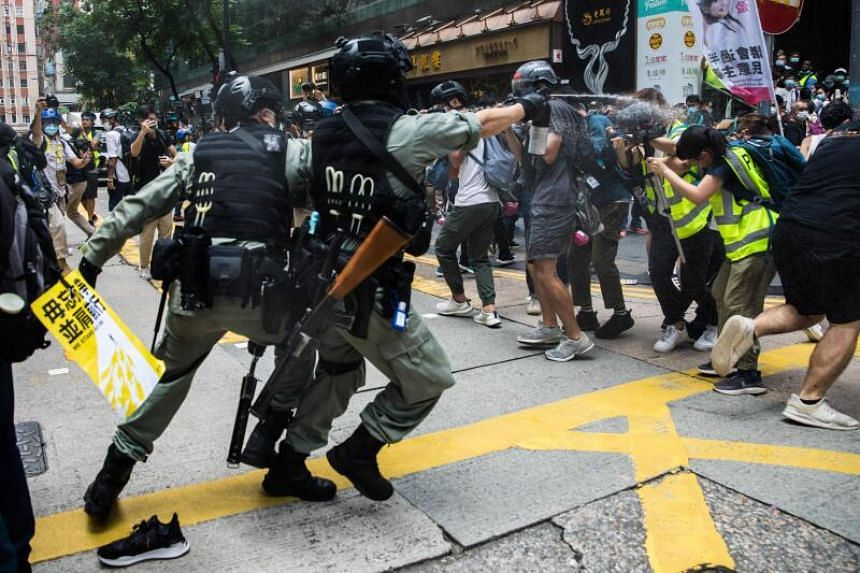Riot police deploy pepper spray as protesters gathered for a rally against a new national security law in Hong Kong, on July 1, 2020.