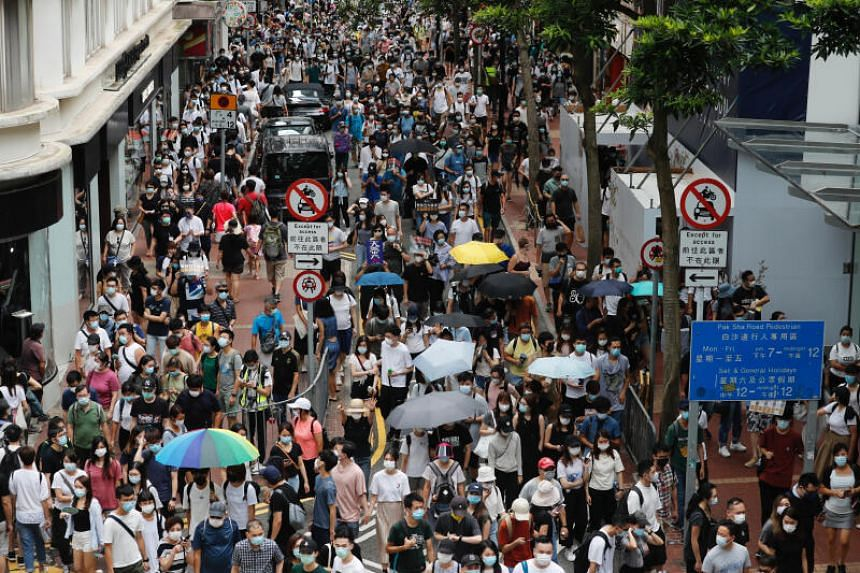 Anti-national security law protesters march at the anniversary of Hong Kong's handover to China from Britain in Hong Kong, on July 1, 2020.