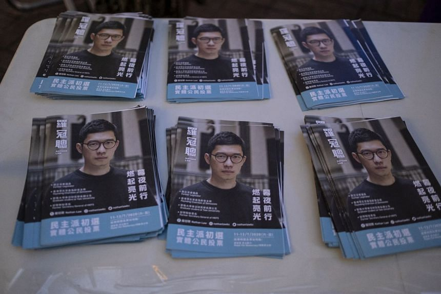 A June 2019 photo shows leaflets featuring Nathan Law at a news conference.
