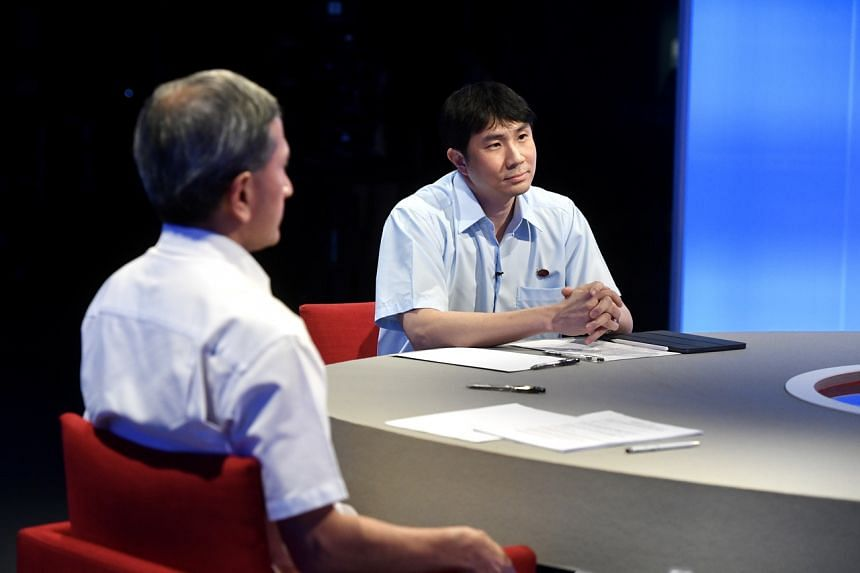 The Workers' Party's Jamus Lim (right) during a live debate broadcast on TV and online on July 1, 2020.