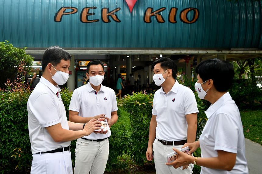 (From left) PAP candidates for Tanjong Pagar GRC Chan Chun Sing, Eric Chua, Alvin Tan, and Indranee Rajah outside Pek Kio Market & Food Centre on July 2, 2020.