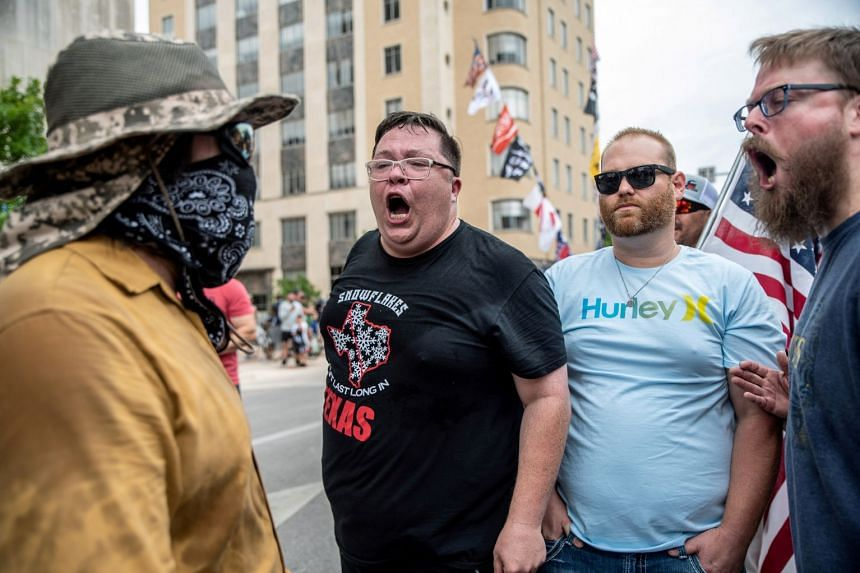 People protest against mandates to wear masks in Austin, Texas, June 28, 2020.