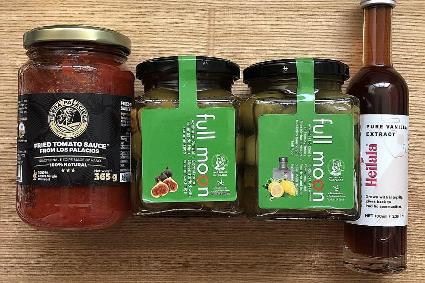 From far left: Fried tomato sauce, olives and vanilla extract from Foster Foods.