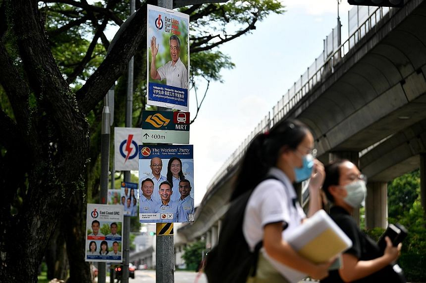 People's Action Party and Workers' Party election campaign posters for East Coast GRC. In tackling Singapore's challenges, we should prefer contesting candidates to offer hope and practical action, says the writer.