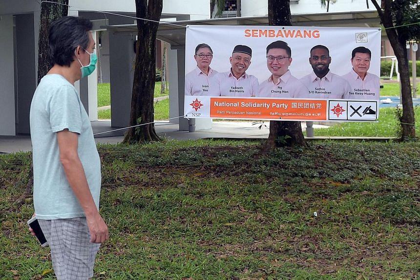 A banner showing National Solidarity Party candidates for Sembawang GRC Ivan Yeo, Yadzeth Hairis, Spencer Ng, Sathin Ravindran and Sebastian Teo. ST PHOTO: ALPHONSUS CHERN