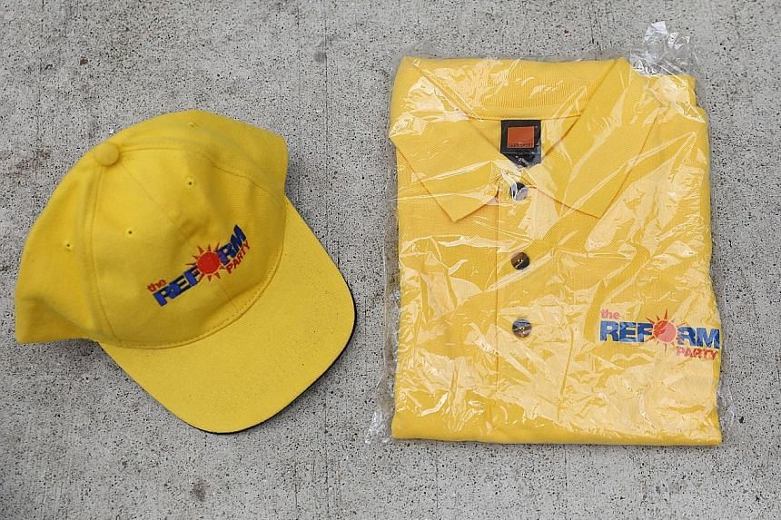 Memorabilia of the Reform Party, which wants a change in the economic model. ST PHOTO: ONG WEE JIN