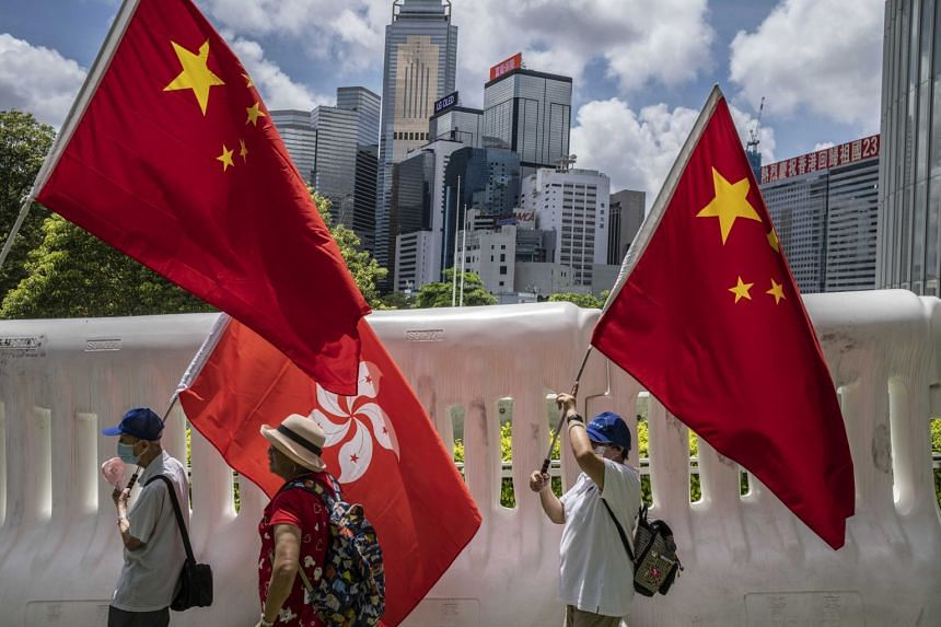 Supporters of the government in Beijing march in Hong Kong on June 30, 2020.