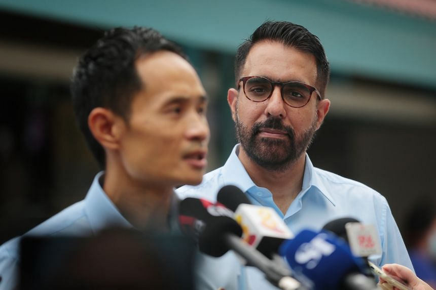 WP secretary general Pritam-Singh looks on as candidate for East Coast GRC Kenneth Foo speaks to the media at Upper Changi Road on July 1, 2020.