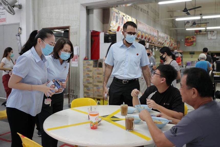 (From left) The Workers' Party's Punggol West SMC candidate Tan Chen Chen, party chairman Sylvia Lim and party chief Pritam Singh during a walkabout in Punggol West on July 3, 2020.