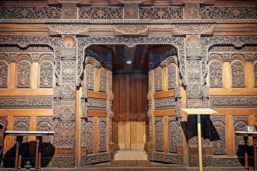 Gebyok typically features intricate floral and phoenix bird carvings in wall-sized partitions made of heavy teakwood.