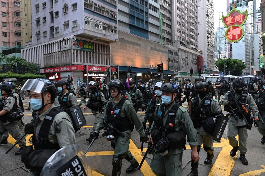 Riot police arrive to disperse protesters in Hong Kong on July 1, 2020.