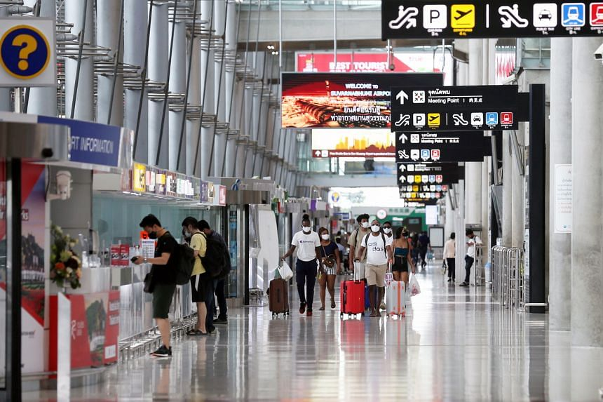 People walk inside Suvarnabhumi International Airport in Bangkok, on July 3, 2020.
