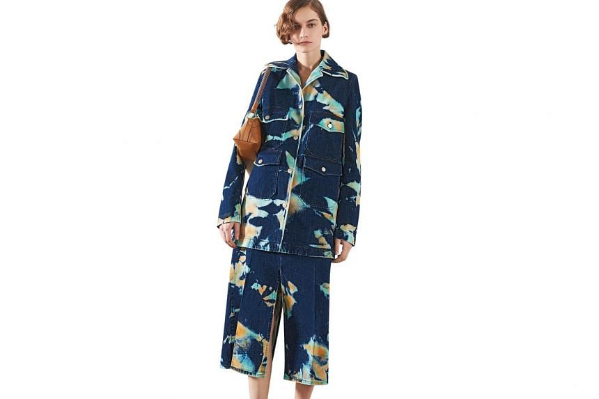 English fashion designer Stella McCartney opted for an oversized skirt suit with splashes of colour for that perfect blend of playful and practical.