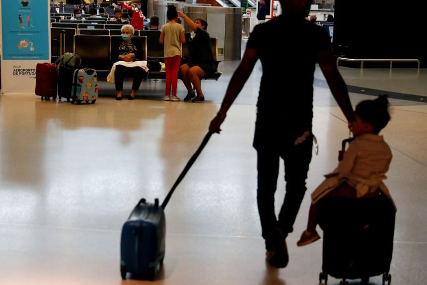 Passengers waiting for flights at Lisbon's airport on June 15, 2020.