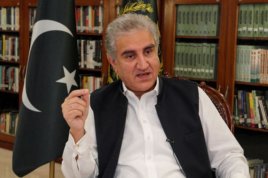 Shah Mehmood Qureshi gestures as he speaks during an interview with Reuters on June 25, 2020.