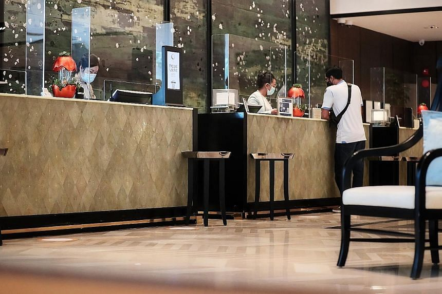 The Shangri-La Hotel's reception counters, fitted with plastic shields to minimise contact as part of safe management measures against Covid-19. The Singapore Tourism Board said hotels must implement measures such as staggering the check-in and check