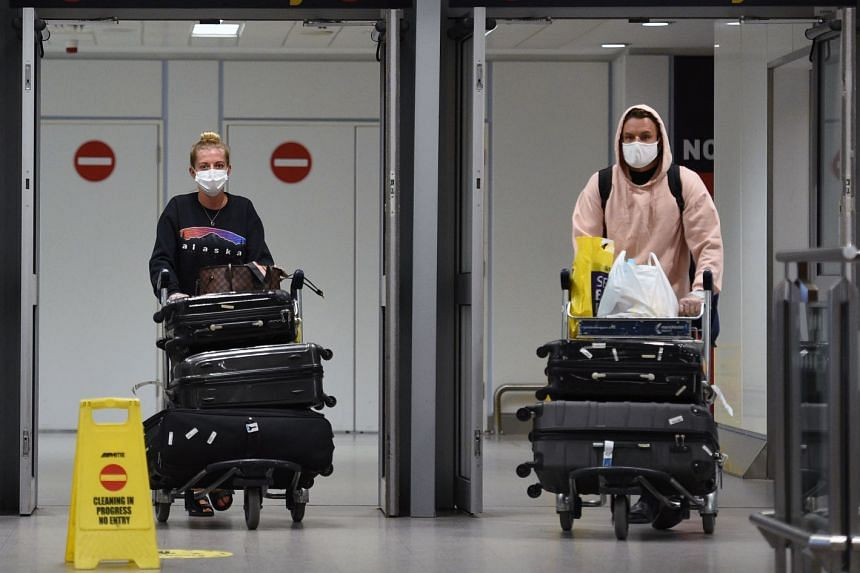 Passengers arrive at Terminal 1 of Manchester Airport in north-west England.
