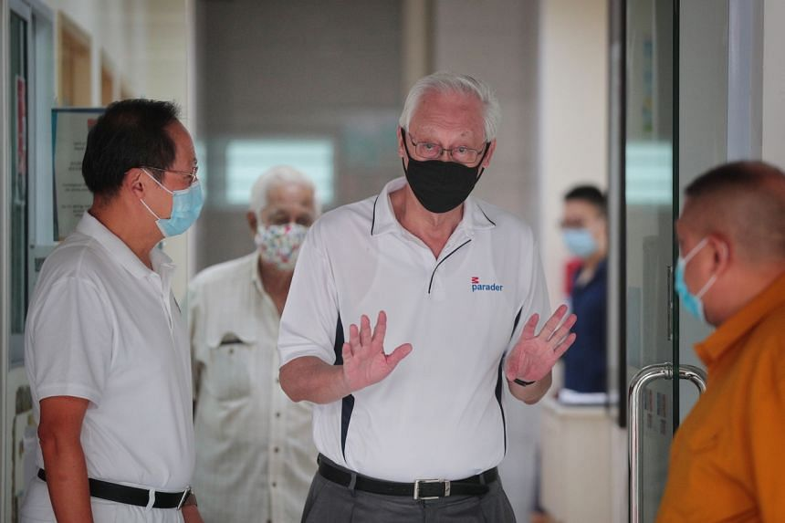 Emeritus Senior Minister Goh Chok Tong joins the PAP's Marine Parade GRC candidate Tan See Leng (left) on a walkabout in Marine Parade on July 4, 2020.