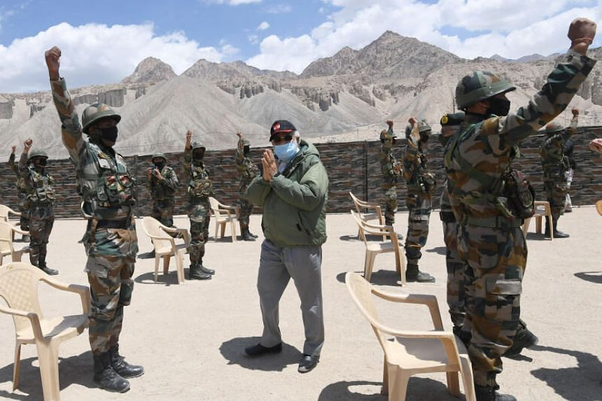 India's Prime Minister Narendra Modi gestures as he interacts with soldiers during his visit to the Himalayan region of Ladakh on July 3, 2020.