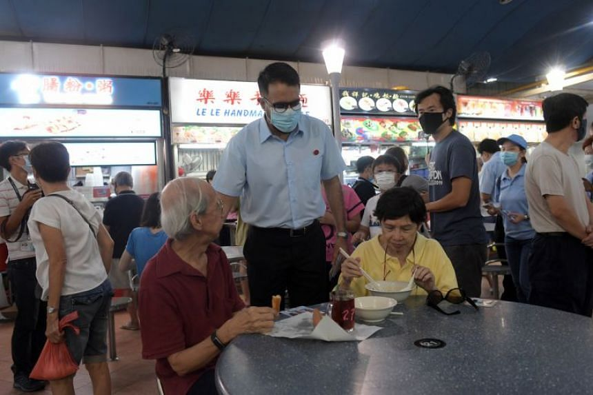 Workers' Party chief Pritam Singh speaks to residents during a walkabout at Marine Terrace Market on July 4, 2020. He accompanied the five-member WP team for Marine Parade GRC.