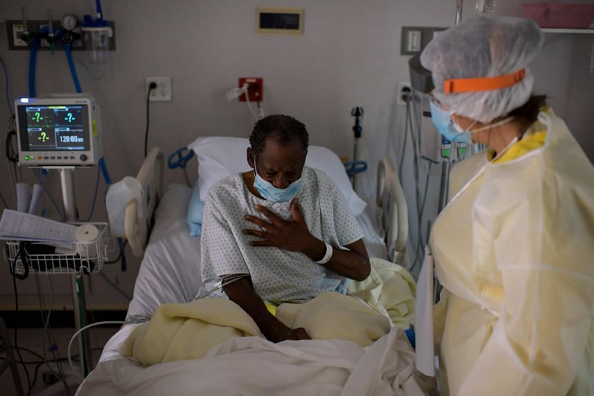 A healthcare worker tending to a patient in the Covid-19 Unit at United Memorial Medical Centre in Houston, Texas, on Thursday, when the state recorded its second-worst day of the pandemic with 7,915 new cases. Governor Greg Abbott ordered face masks