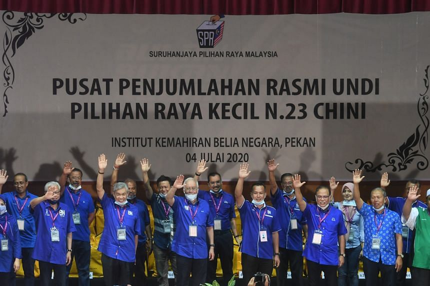 Barisan Nasional candidate Mohd Sharim Md Zain (fourth from right) celebrates his win at the Chini by-election in Pahang on July 4, 2020.