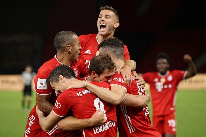 Bayern Munich players celebrate after the match.