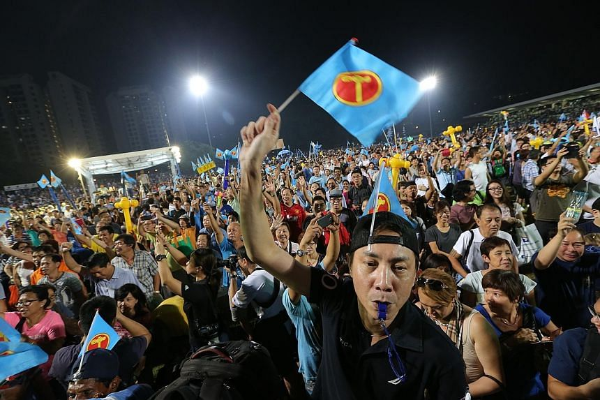 The crowd at the Workers' Party rally for East Coast GRC at Bedok Stadium during the 2015 General Election. This year, the WP's first episode of the Hammer Show drew more than 120,000 views by midnight, noted one analyst. Despite the convenience of e