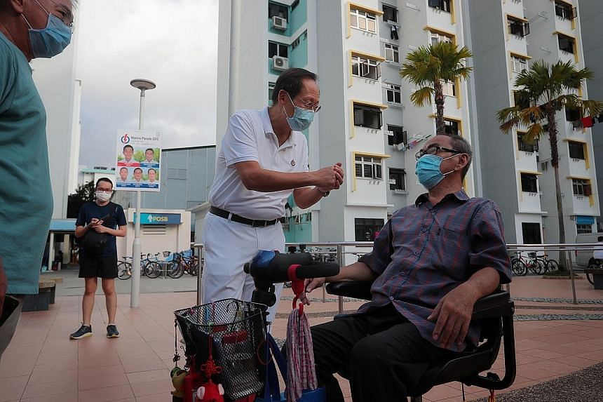 Dr Tan See Leng, one of the five PAP candidates for Marine Parade GRC, campaigning in the constituency yesterday. The former head of a healthcare group wants to build a network to support caregivers of the elderly.