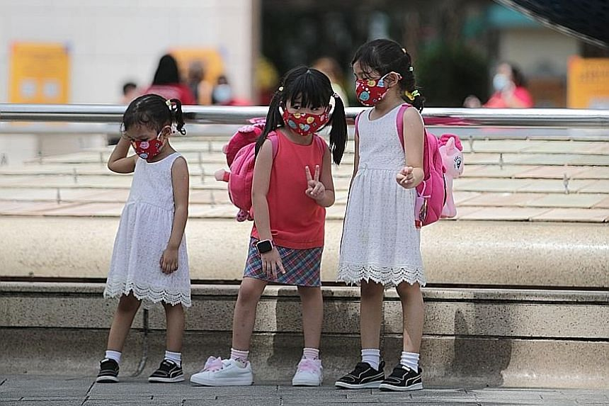 Children outside Universal Studios Singapore yesterday. A steady stream of visitors was seen entering the attraction when The Sunday Times visited. Visitors outside the S.E.A. Aquarium in Sentosa yesterday. A visitor said she was not worried about sa
