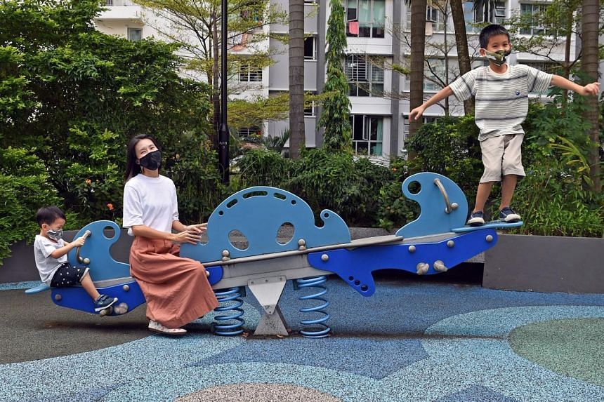 To help her sons Aden (left) and Azel cope with the closure of recreational facilities during the circuit breaker, Ms Serene Wu got them to list the things they wanted to do. They visited the playground after it reopened.
