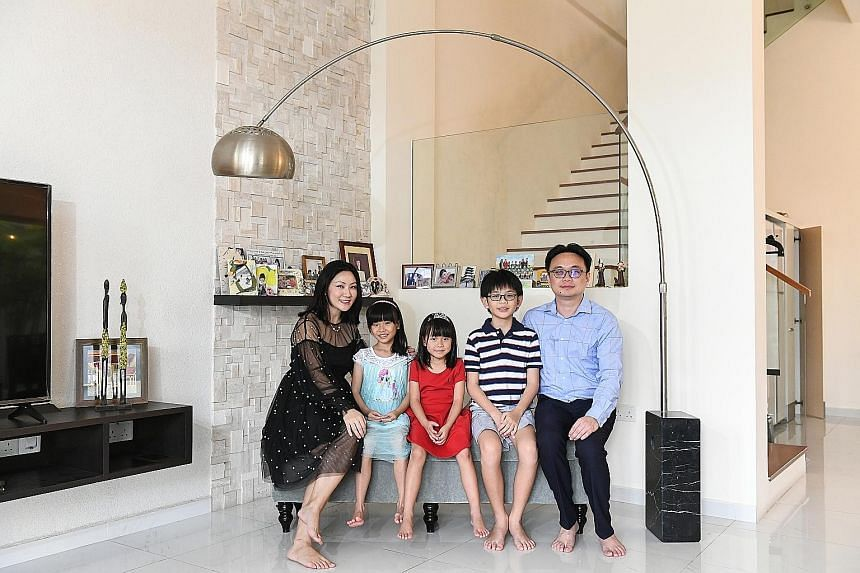 Cushman & Wakefield research head Christine Li with her husband, orthopaedic surgeon Chew Chee Ping, 40, and children Genevieve (in blue), seven, Gwendolyn, five, and Lucas, 10. Their Serangoon Gardens corner terrace house has a land size of 2,800 sq ft a