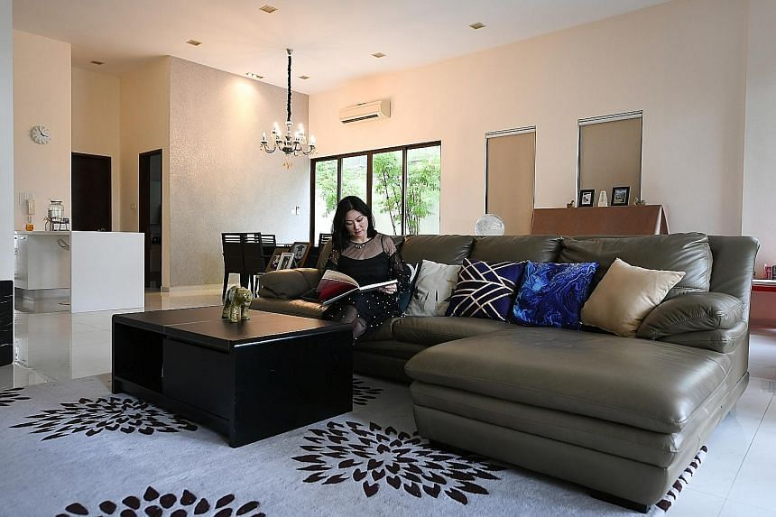 Ms Li in the living room of her Brockhampton Drive home, which has seven bedrooms, two of which are being used as study rooms.